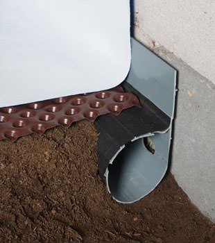 Closeup of a crawl space drainage system installed in Travelers Rest