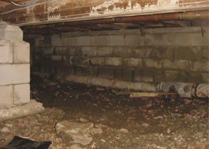 Rotting, decaying crawl space wood damaged over time in Swannanoa