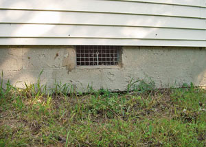 Open crawl space vents that let rodents, termites, and other pests in a home in Canton